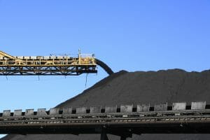 A conveyor belt carrying coal.