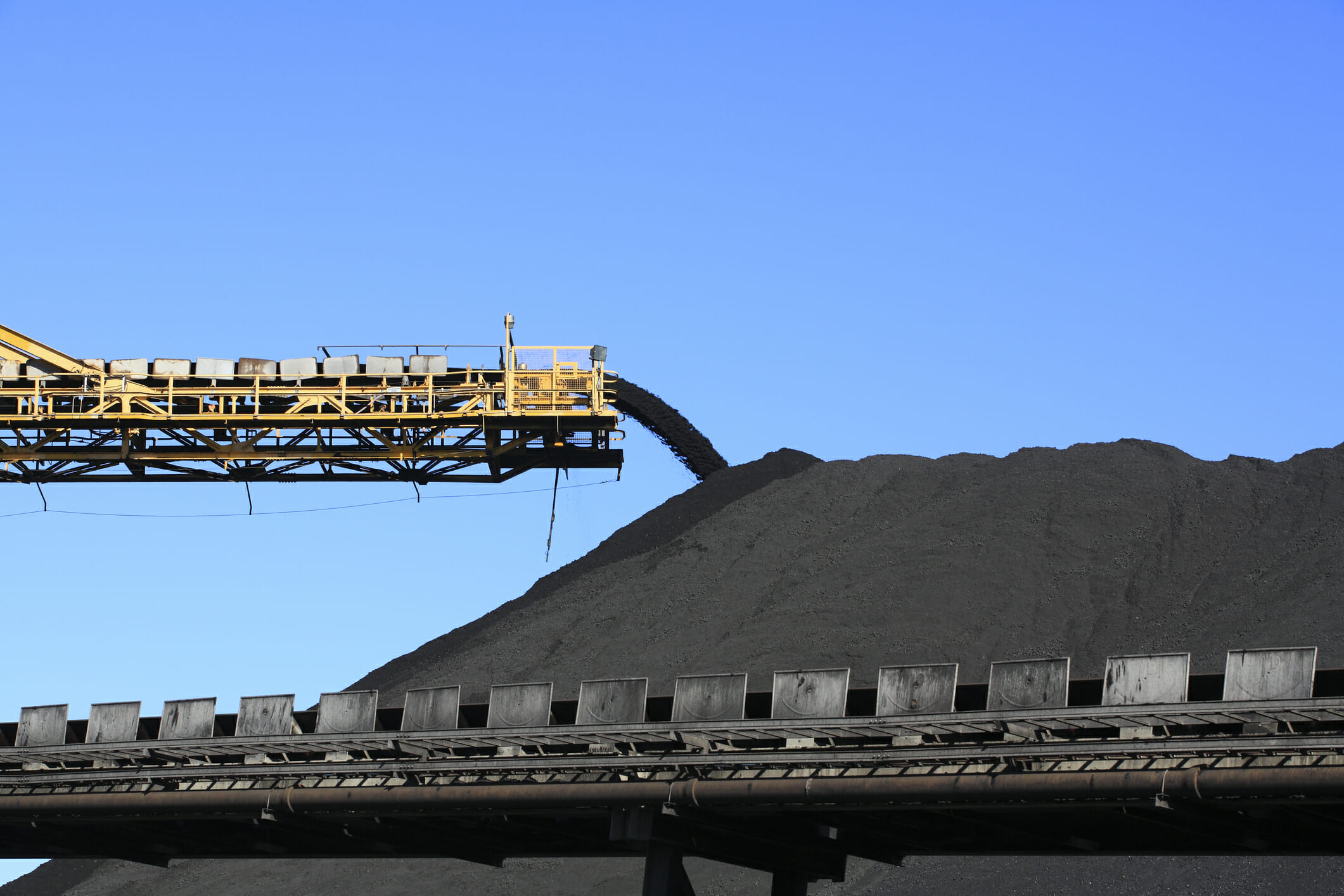 A conveyor belt carrying coal.